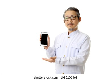 The Asian man standing on the white background with Thai classic dressed.