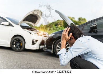 Asian man stressed and at Roadside After Traffic Accident
