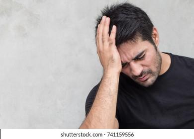 asian man suffering from headache, vertigo, hangover, migraine, stress