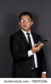 Asian man with tablet.