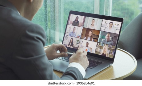 Asian man talking to multi ethnic group of business people working from home and office, talking to colleagues in webcam group video call conference technology on screen online in quarantine. Team - Shutterstock ID 1936284691