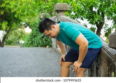 Asian man tired from running exercise.