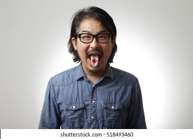 The Asian man with tongue out.