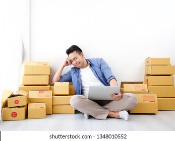 Asian man with unsuccess business online shopping crying and serious face unhappy mood