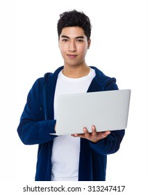 Asian man use of the notebook computer