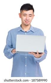 Asian man using laptop computer