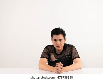 Asian man in vary actions.