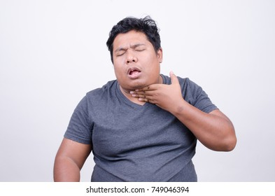 Asian man with vomiting expression