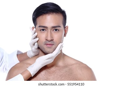 Asian man want to check eye, nose, eyebrow, forehead, cheek, jawline before plastic surgery, touch by nurse's rubber gloves, studio lighting white background copy space for text logo