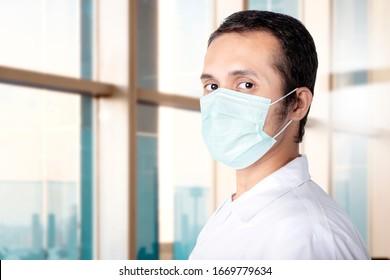 Asian man wearing a flu mask in the hospital. Prevent flu disease Coronavirus