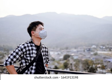 Asian man wearing a mask to protect himself from air pollution, pm2.5 dust