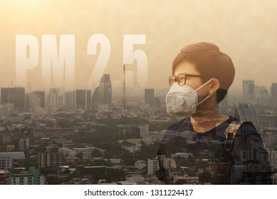 Asian Man Wearing N95 PM 2.5 Protective Mask Anti Air Pollution on Dust Smog City Background Bad Environment