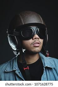 Asian Man Wearing Retro Helmet and Gogles