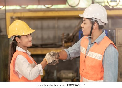 asian man and women workers factory working at steel heavy machine. people shaking hands and standing in industrial factory. professional engineering training new staff.