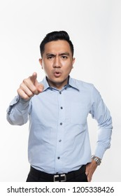 Asian man in work attire being angry pointing at the camera