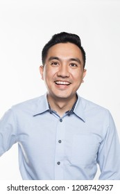 Asian man in work attire looking very happy