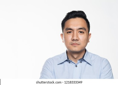 Asian man in work attire with serious face