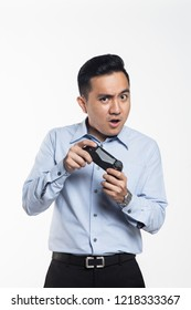 Asian man in work cloth playing console game