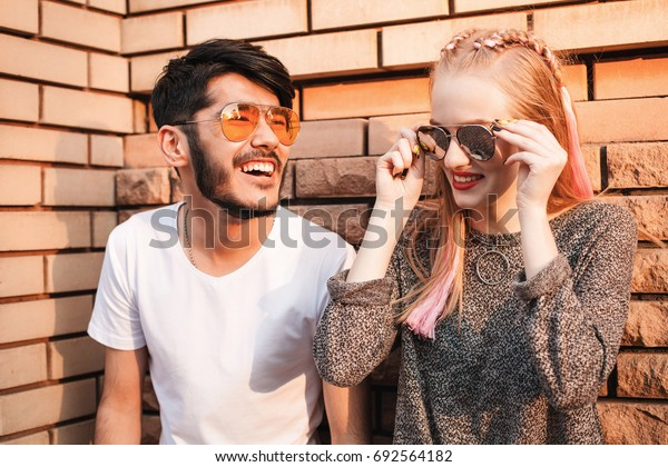 Asian man and young female are having time in the city.