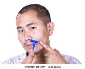 asian man's shaving