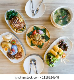 Asian meal dishes including Laphet, Nasi Lemak, Drunken Noodles with grilled pork, Grilled sticky rice with egg and Hot and Spicy Soup with Pork Rib.
