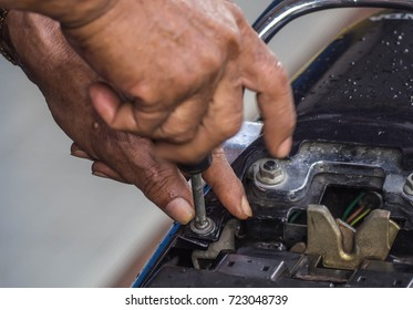 Asian Mechanic hand was fixing a motorcycle