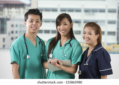 Asian Medical team of doctors and nurses standing in a hospital.
