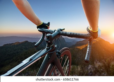 Asian men are cycling road bike in the the sunset,Silhouette of the cyclist on bike at sunset