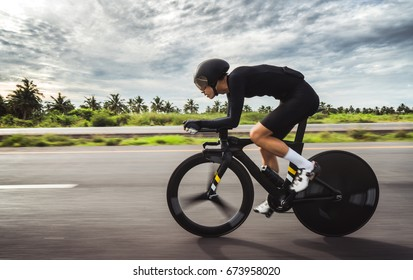 "Asian men are cycling ""time trial bike"" in the morning"