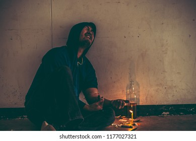 Asian men are drug addicts to inject heroin into their veins themselves.Flakka drug or zombie drug is dangerous life-threatening,Thailand no to drug concept,The bad guy drugs in the desolate