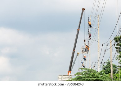 Asian men engineering working on high voltage workfield at countryside
