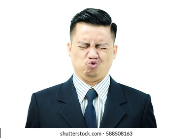 Asian men are exercising facial muscles, pucker up and eyes closed