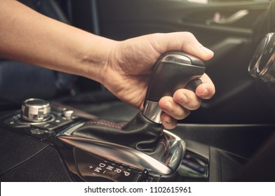 Asian Men handle hold to gear stick lever Start driving vehicles.On a hot day.