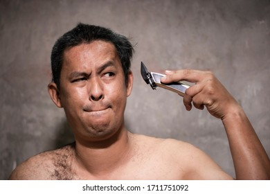 Asian men are learning to cut their own hair due to The corona virus or Covid-19 is spreading. Most people have to stay home to reduce the outbreak.