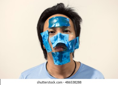 Asian men with oily face skin and use removing oil film,Skin care Concpet