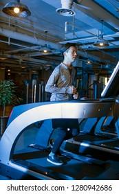Asian men running in the gym
