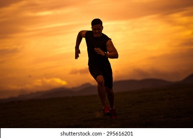 Asian men are siluate jogging at a speed in the evening