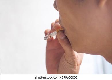 Asian men smoking cigarette
