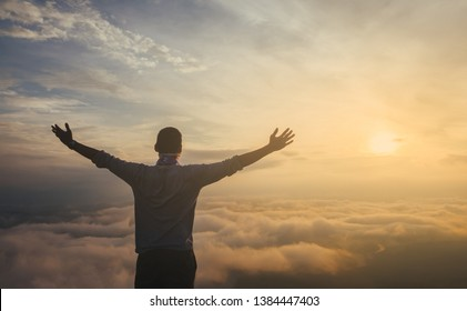 Asian men Travel Holiday Relaxation Concept , Vintage Style,sunrise clouds on top of mountain with misty.enjoying beautiful cloudscape.open arms