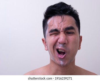 Asian men are washing their face with foam , Men skin care concept