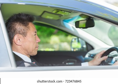 Asian middle age businessman and car