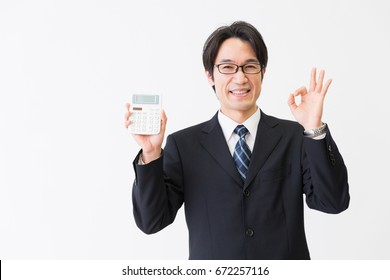Asian middle age asian businessman having an electronic calculator