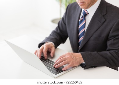 Asian middle age businessman using laptop,hands,