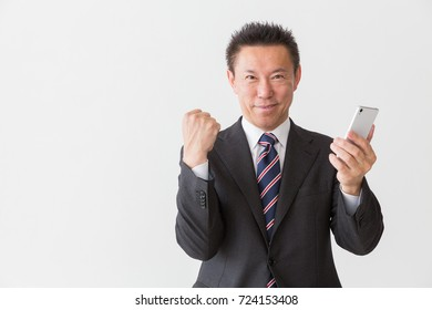 Asian middle age businessman who uses smart phone