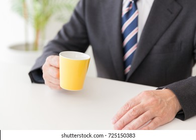 Asian middle age man who drink coffee,hands,