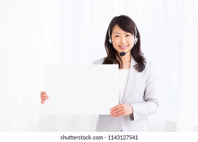 Asian middle age woman holding blank white board,operator,