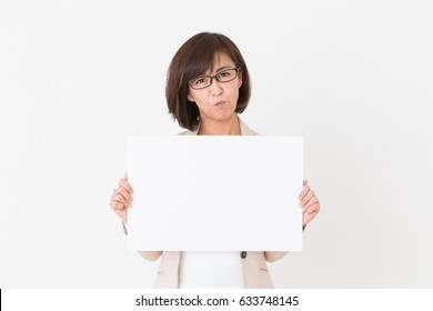 Asian middle age woman holding blank white board,think,