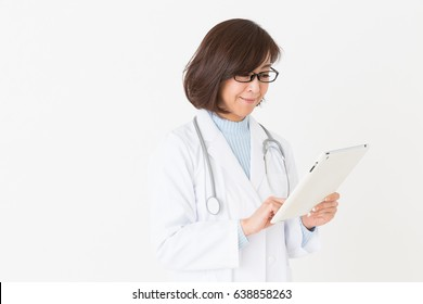 Asian middle age woman in a white coat