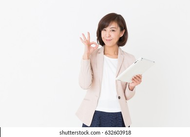 Asian middle age woman who uses  tablet computer,