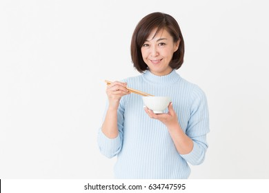 Asian middle age woman who eats